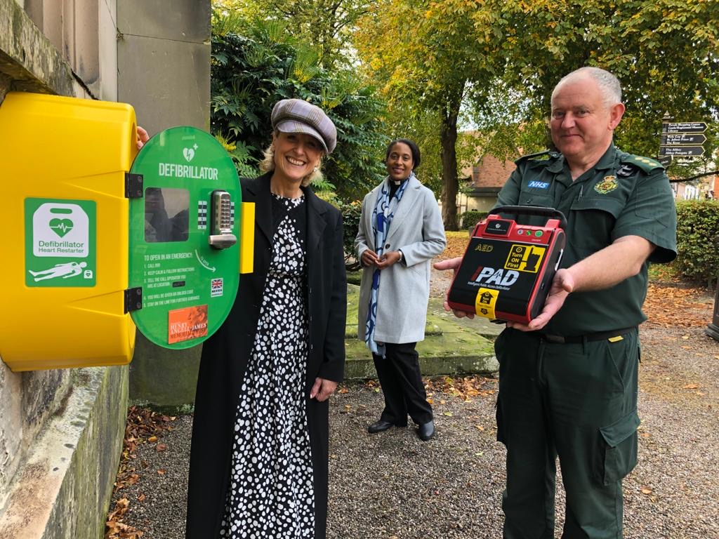Sally Angell-James with West Midlands Amubulance Service's Cliff Medlicott and Rev Yejide Peters of St Alkmunds Church launching the charity in Shrewsbury.